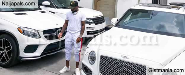d89e185bb80 All-White everything! Davido is twinning with his White Mansion, by  dressing in an all white outfit to take photos in front of his white  Bentley, ...