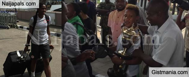 Victorious Super Falcons Flaunt The Trophy As They Arrive MMA, Lagos