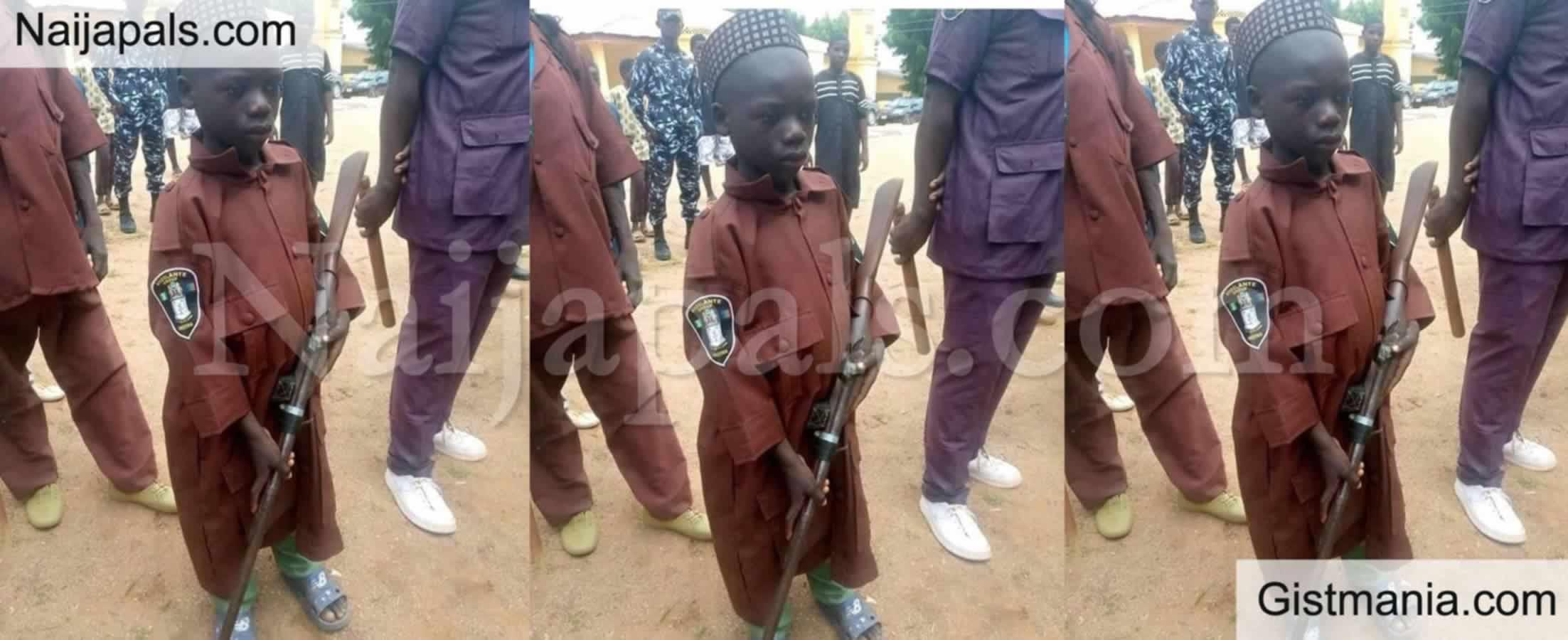 <img alt='.' class='lazyload' data-src='https://img.gistmania.com/emot/shocked.gif' /> Photo Of A<b> 10-Year-Old Vigilante Member In Katsina Carrying Gun Goes Viral</b>