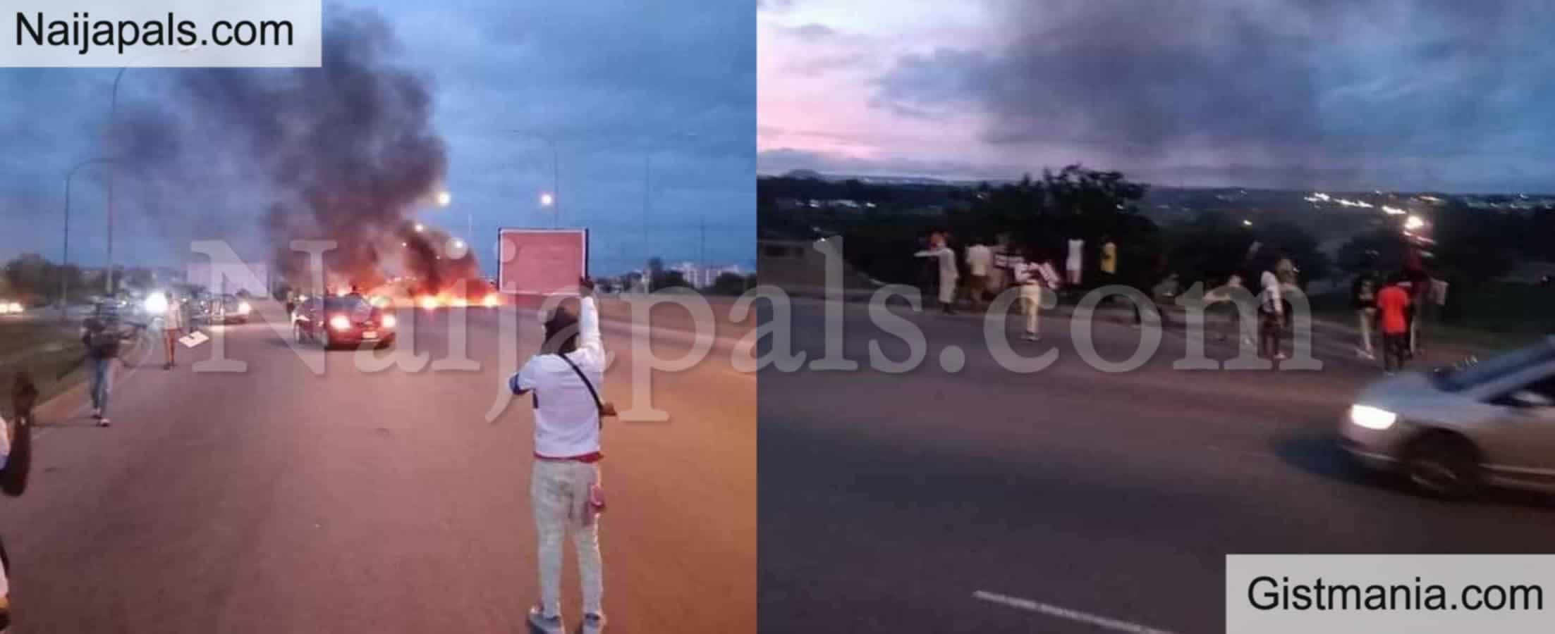 <img alt='.' class='lazyload' data-src='https://img.gistmania.com/emot/comment.gif' /> PIC/VID: <b>#BuhariMustGo Protesters Block Abuja Airport Road, Set Bonfire</b>