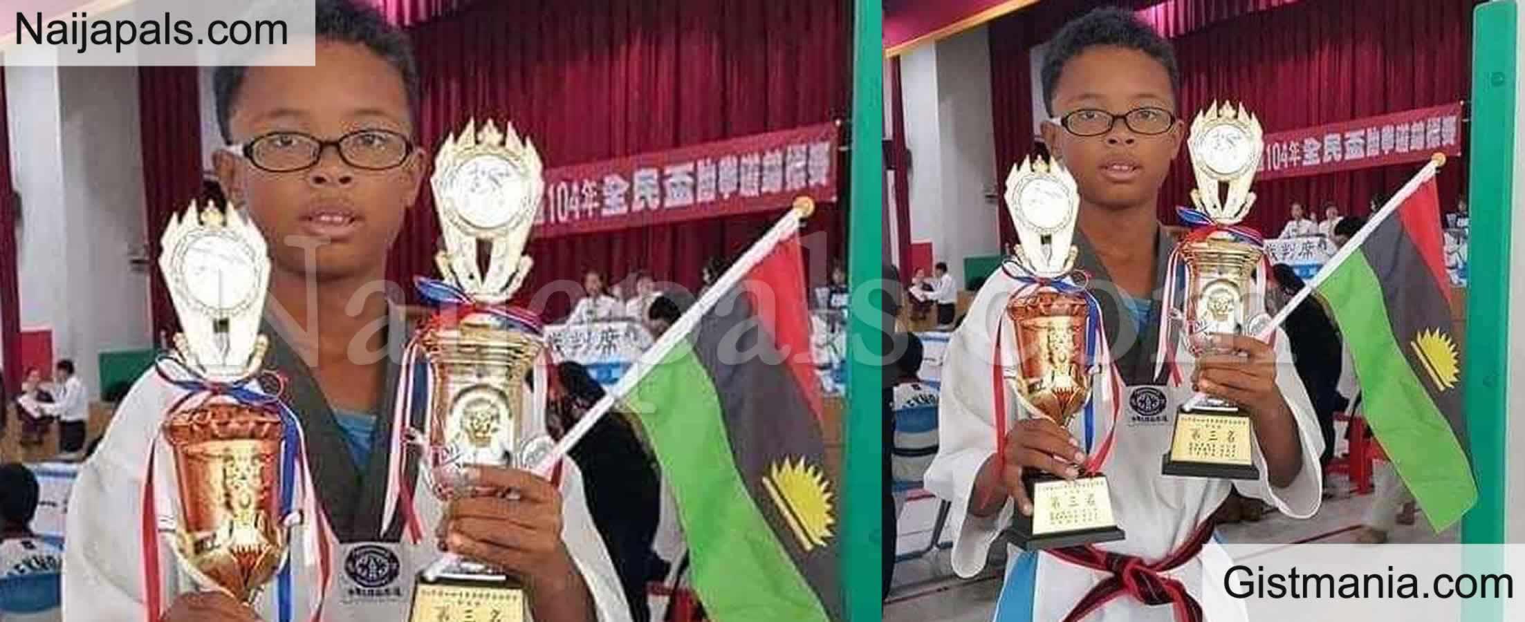 <img alt='.' class='lazyload' data-src='https://img.gistmania.com/emot/comment.gif' /> PHOTOS: <b>Nigerian Boy Celebrates With Biafran Flag As He Emerges Taekwondo Champion In China</b>