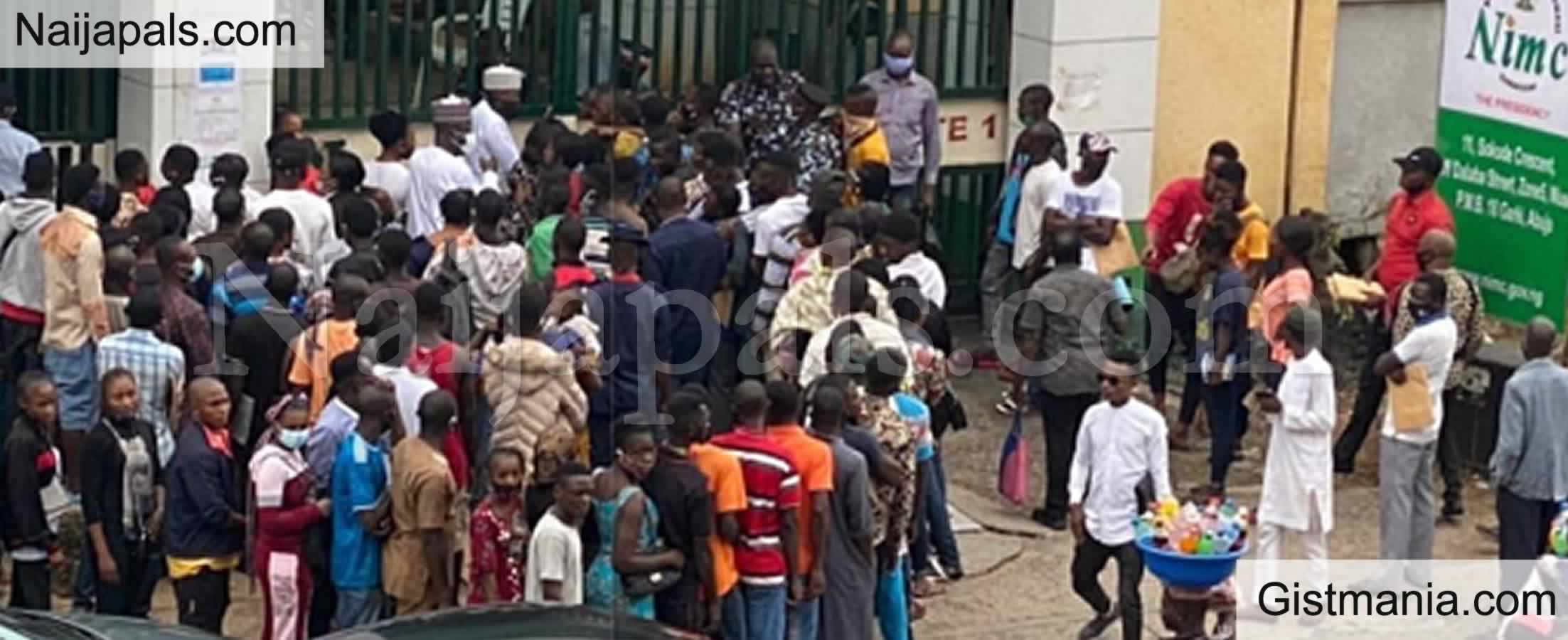 <img alt='.' class='lazyload' data-src='https://img.gistmania.com/emot/photo.png' /> PHOTOS: <b>Nigerians Shun Social Distancing As They Storm NIMC Office in Abuja For National ID</b>