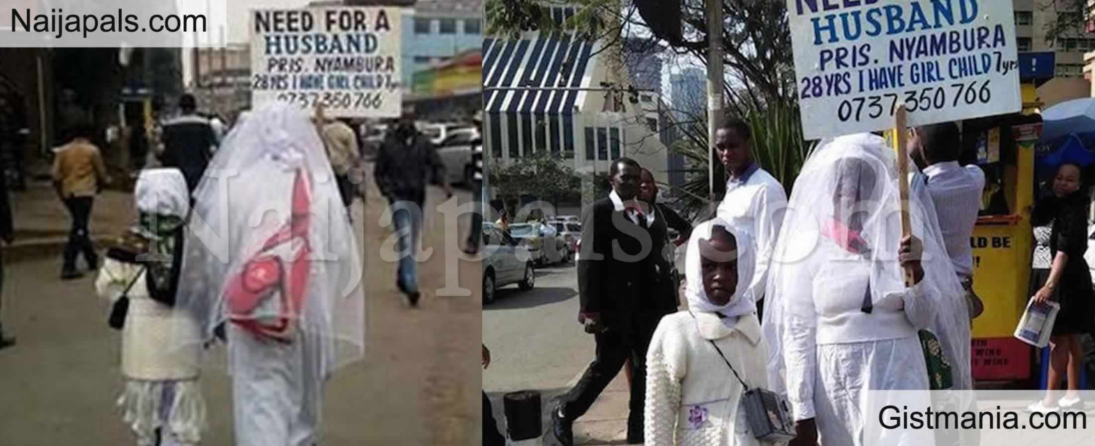 <img alt='.' class='lazyload' data-src='https://img.gistmania.com/emot/video.gif' /> <b>Pretty Lady Wearing Wedding Gown Storms Streets With Placard in Search Of A Husband</b>