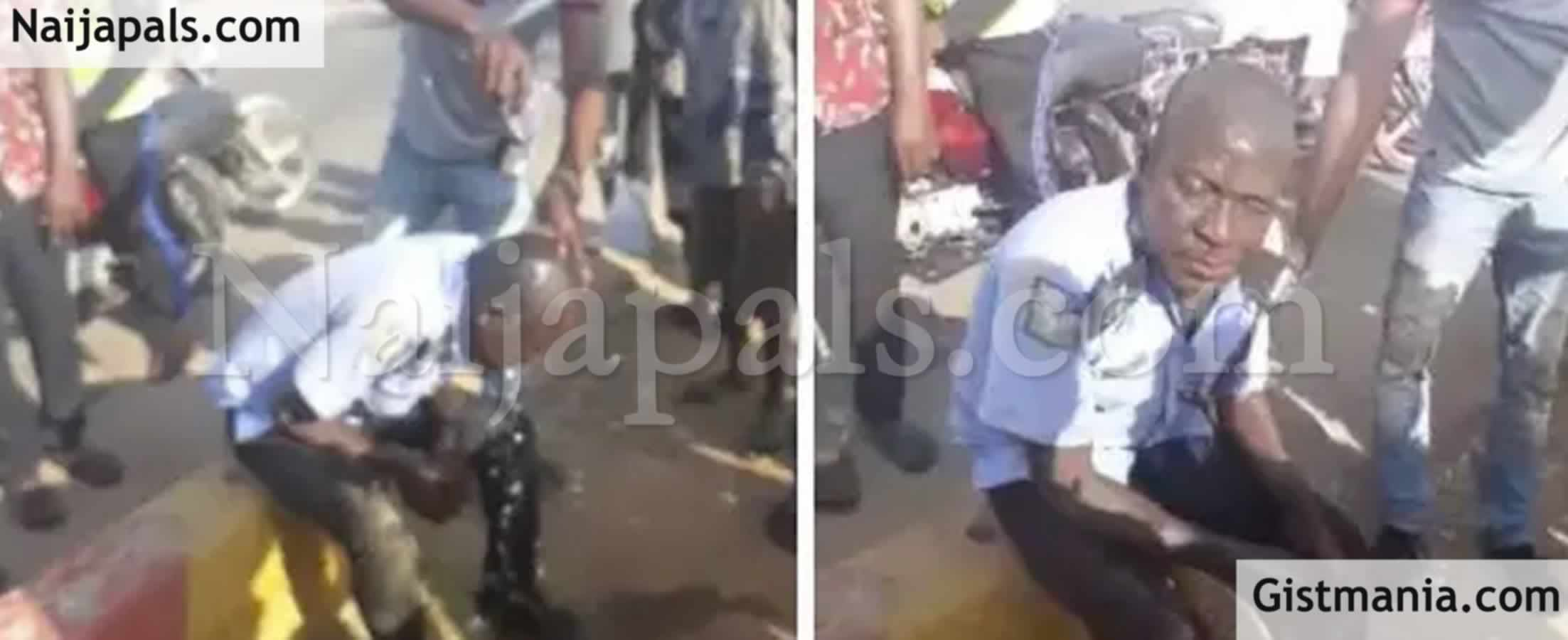 <img alt='.' class='lazyload' data-src='https://img.gistmania.com/emot/video.gif' /> SHAME! <b>Viral Video Of Drunk Policeman Rescued By Passers-by In Abuja, His Rifle Seized</b>