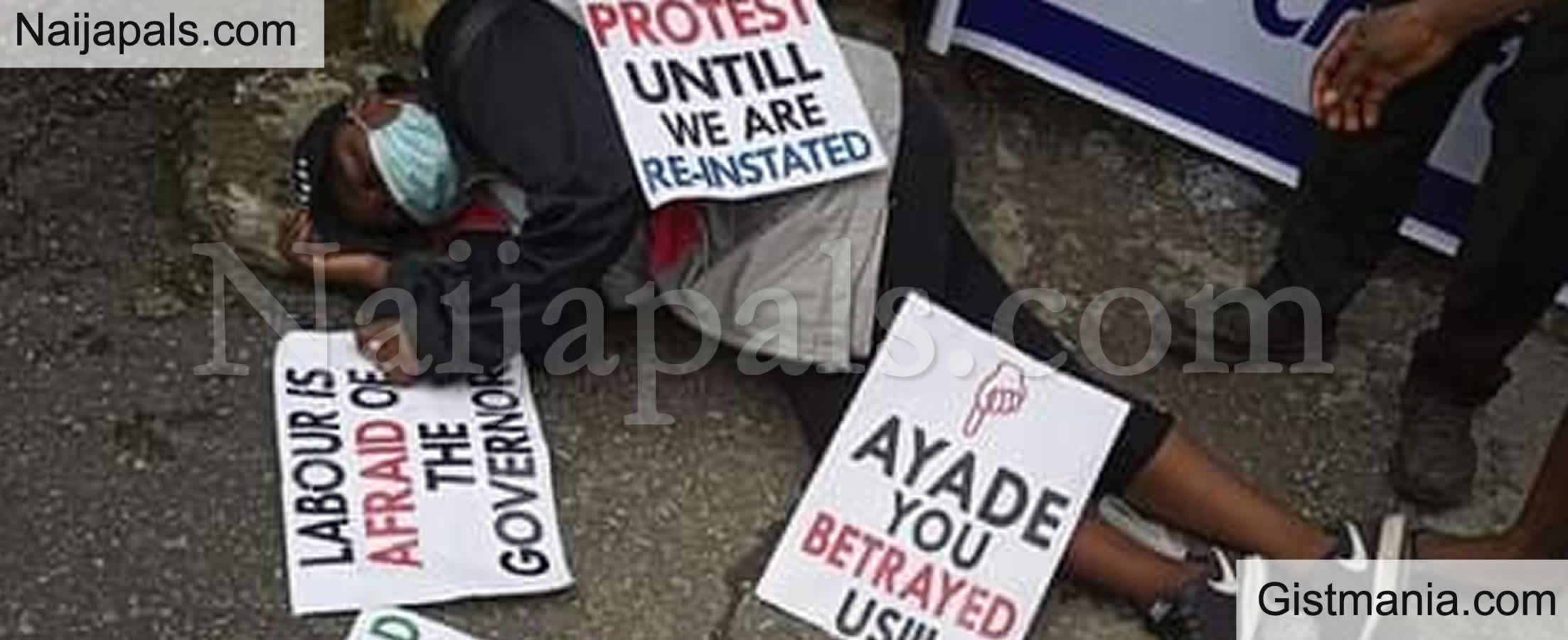 <img alt='.' class='lazyload' data-src='https://img.gistmania.com/emot/shocked.gif' /><b> Photo Of Unidentified Lady Slumps While Protesting Against Sack By Cross River Govt.</b>